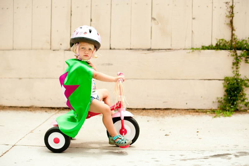 Caped Kid on a Bike